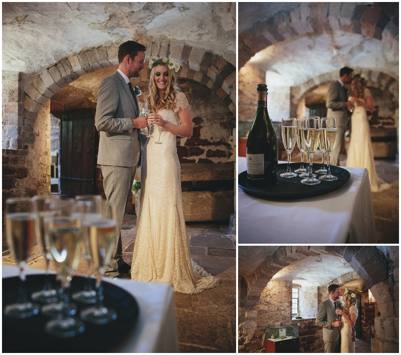 Bride and groom have drinks in the cellar