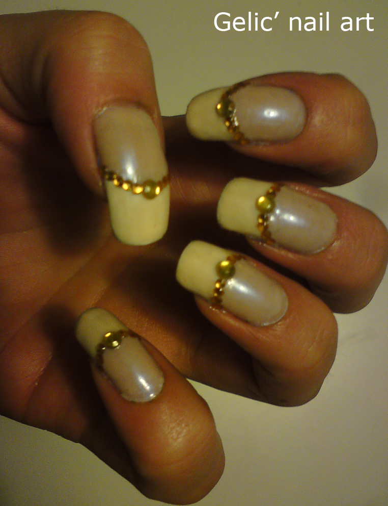 Gelic\' nail art: Classical french manicure with yellow rhinestones