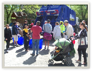 Families lined up to visit recycling truck.