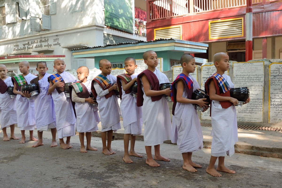 Young monks at Mahagandayon Monastery in white robes