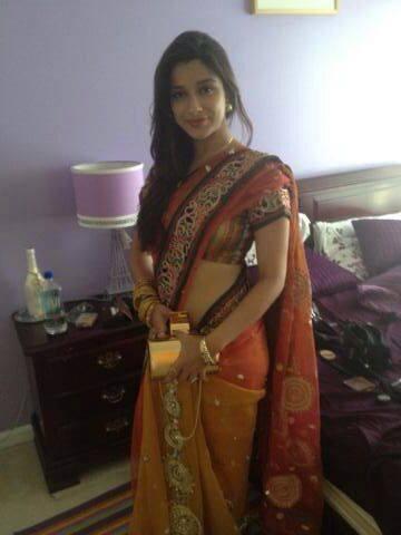 Madhurima banerjee in red saree