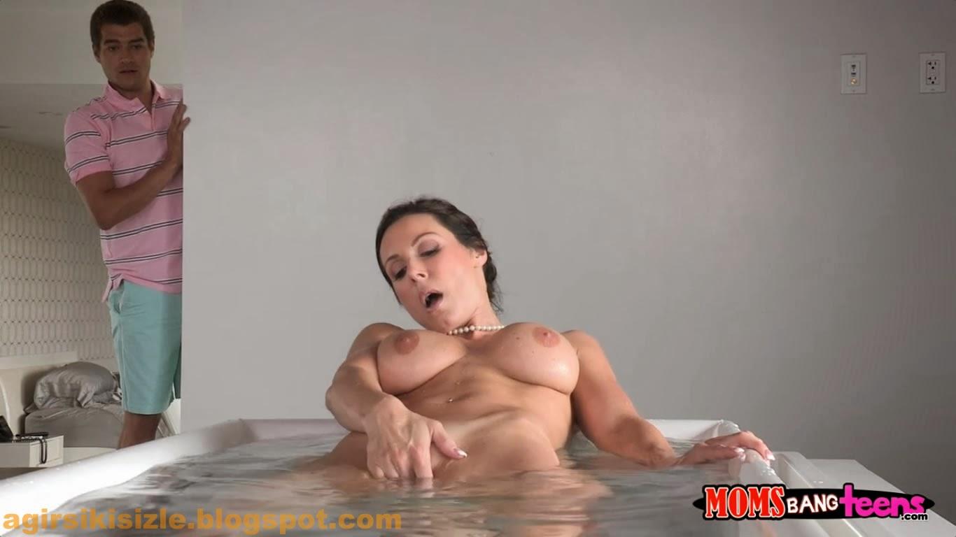 carolin strips pink micro bikini in the pool on bikini pornstar