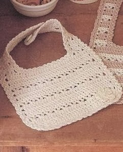 http://patronesparacrochet.blogspot.com.es/2014/02/babero-infantil-crochet-elegante-patron.html