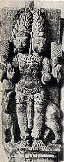 The two headed Agni, the fire-god, riding a ram; South Indian temple carving.