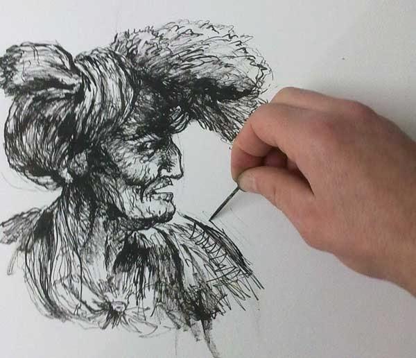 cabeza de hombre con palillo y tinta