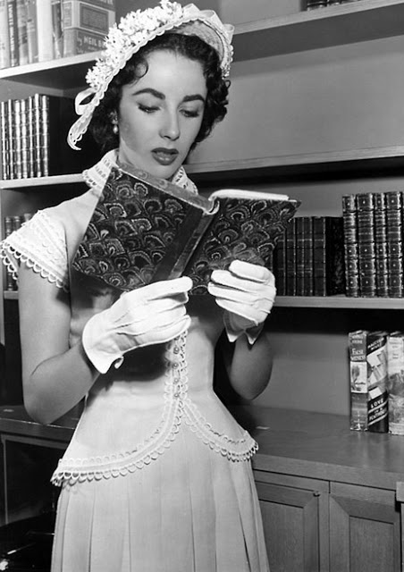 Elizabeth Taylor reading a book