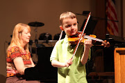 . began taking violin this spring. They both did a wonderful job on their .