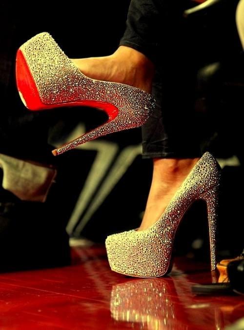 Orange bottom shiny silver high heel for ladies