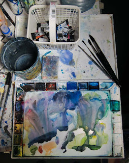 A photo of the John Pike palette cover being used store brushes, paints, and a sponge
