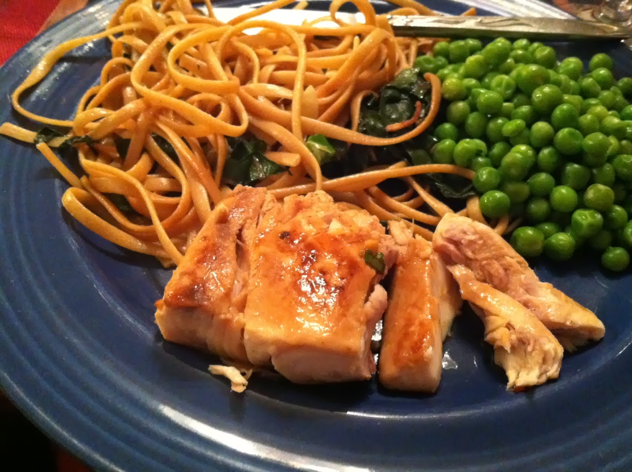 Pan-Seared Mahi Mahi served with noodles and peas