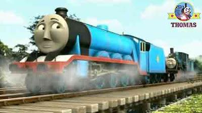 Steam train Thomas the tank engine Gordon the blue engine and Ferdinand the train old railway bridge