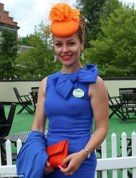 elegant lady in royal blue dress and orange hat on day 2 at Royal Ascot 2014