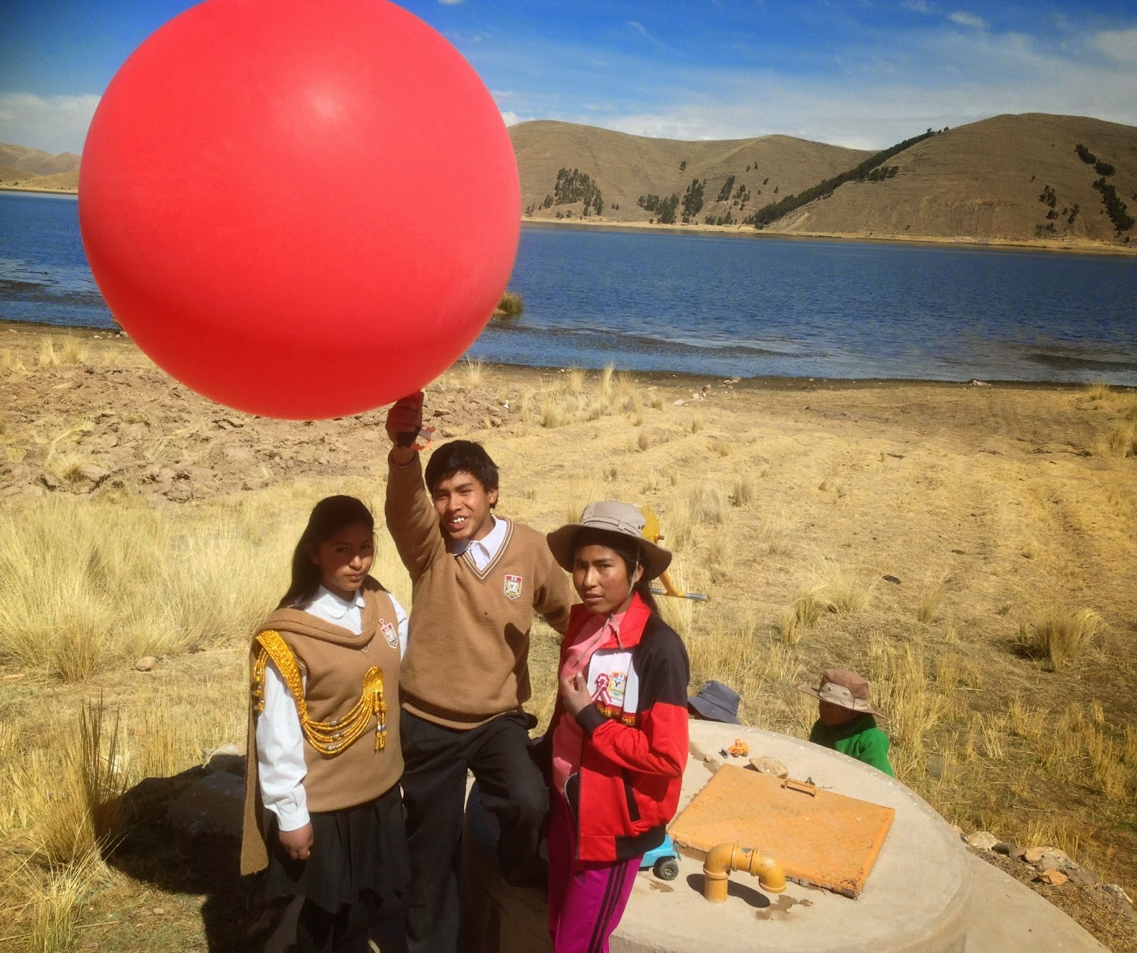 mario melgar students at laguna chacas with an aerial mapping weather balloon