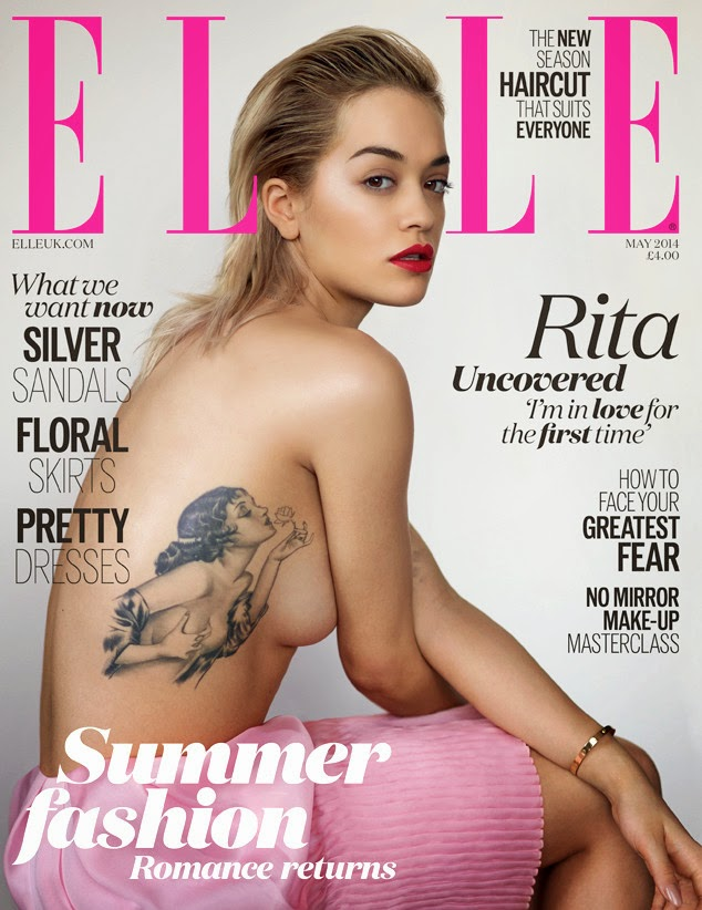 Beauty Rita Ora never ceases to amaze us, and the singer does just that in the May issue of Elle UK, posing completely topless on the cover. who was photographed by Thomas Whiteside, showed off her sexy side on the provocative cover, giving fans a good glimpse at her side boob and sizable Rosetta tattoo decorating her ribcage. articles and images from http://1styahoo.blogspot.com/.
