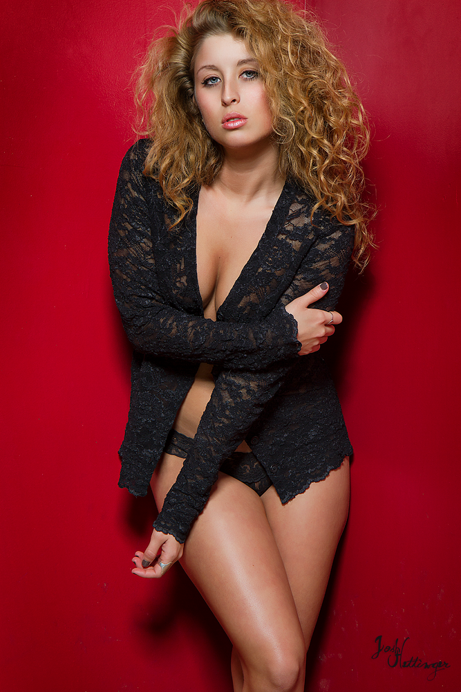 curly hair model, in studio, posing boudoir