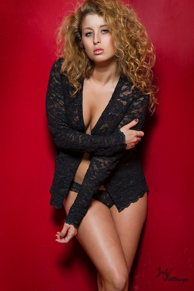 curly hair model, in studio, posing boudoir