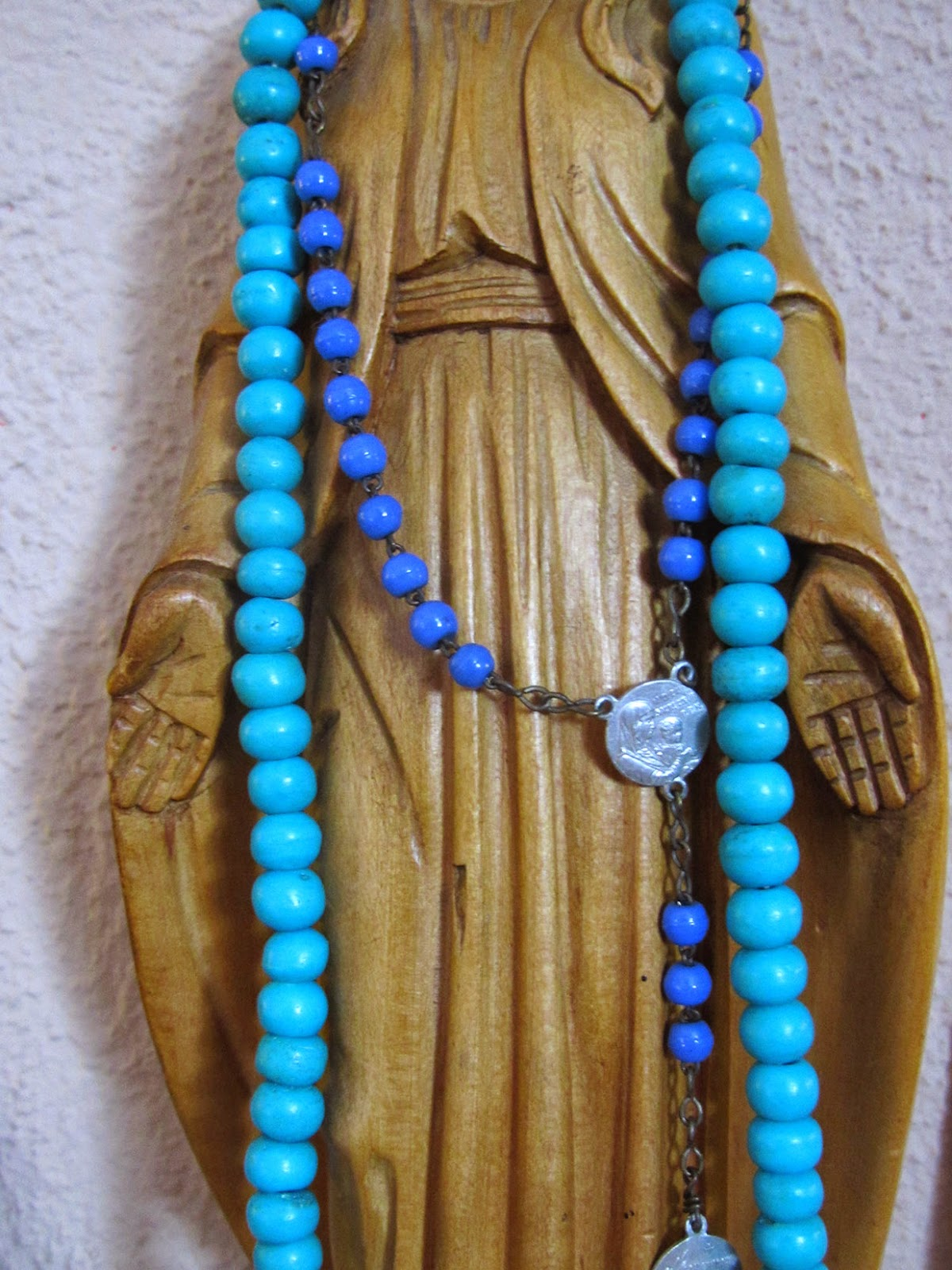 virgin Mary with rosary and mala
