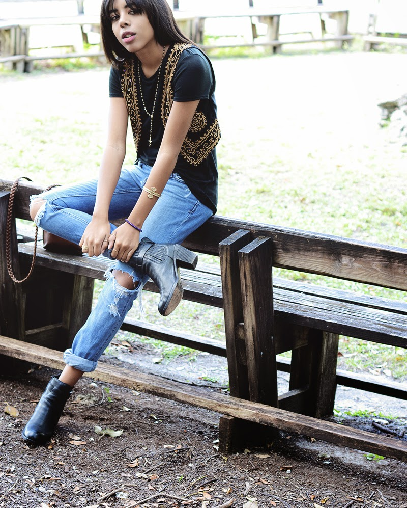 Miami Fashion Blogger Anais Alexandre of Down To Stars in Abercrombie jeans with a Forever 21 vest and Mossimo top with Dolce Vita Boots