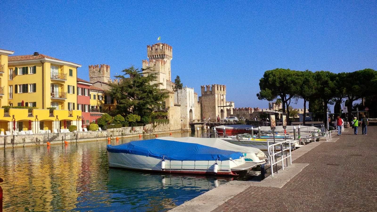 Sirmione's castle with boats in the harbour