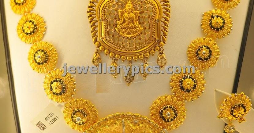 24 Carat Gold Flower Haram With Round Locket Latest