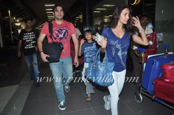 Arbaaz with wife Malaika and son returning at the airport -  Arbaaz, Malaika and son Arhaan Khan  - airport pics