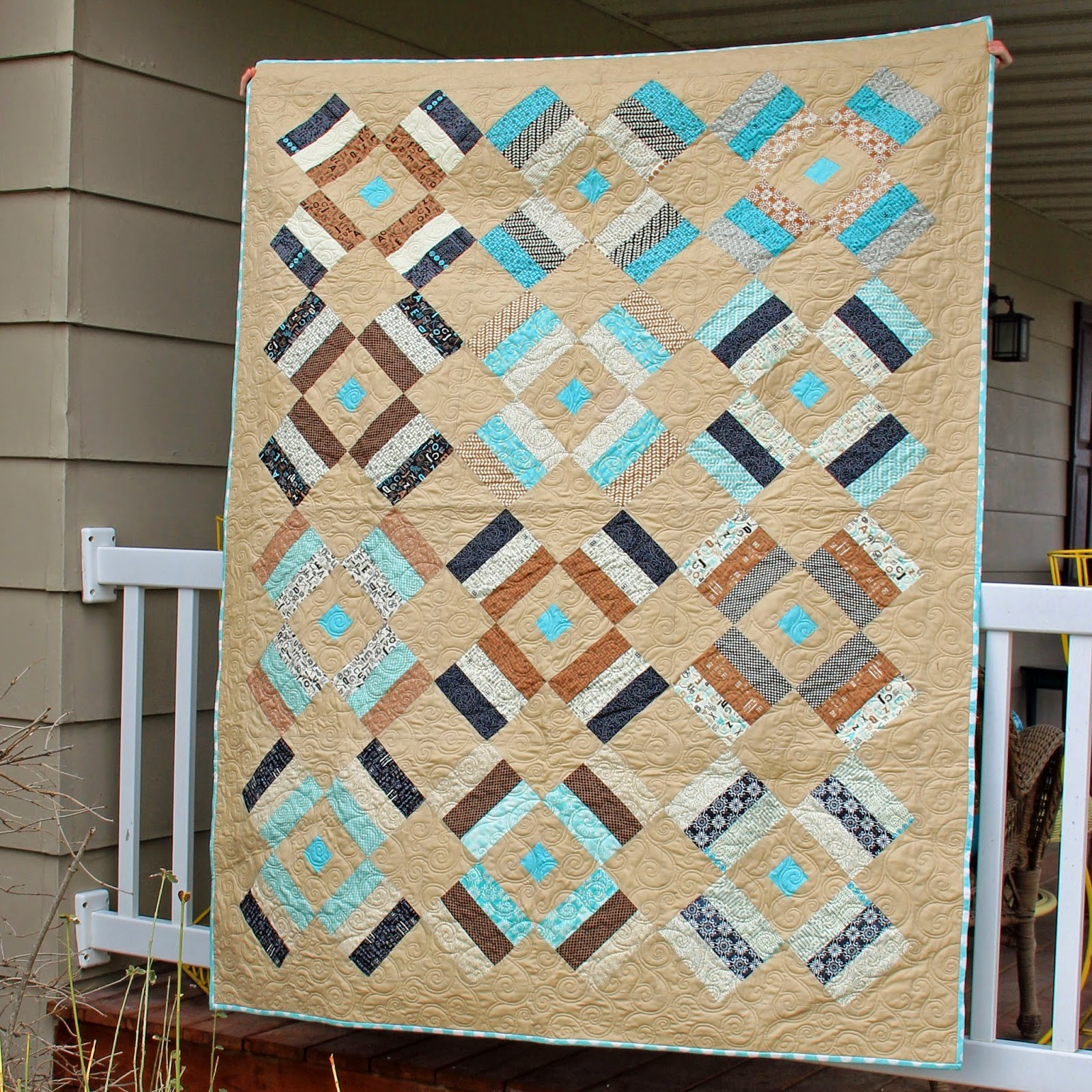 Lap quilt from Sweetwater's Elementary Fabric line by Moda using a jelly roll and a pattern from Strip Savvy book.