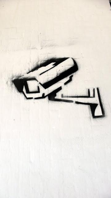 street art in santiago de chile stencil arte callejero surveillance camera