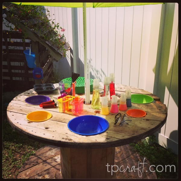 Giant spool upcycled into an outdoor science lab for Kitchen set for 9 year old