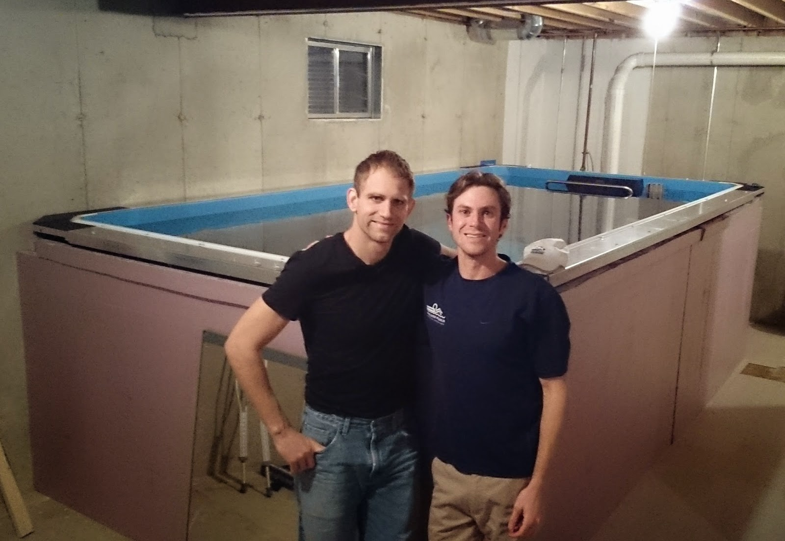 Andrew Starykowicz and Adam Alper, having just installed Andrew's Performance Endless Pool.