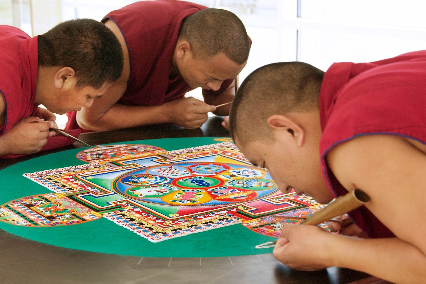 Tibetan monks creating impermanent art