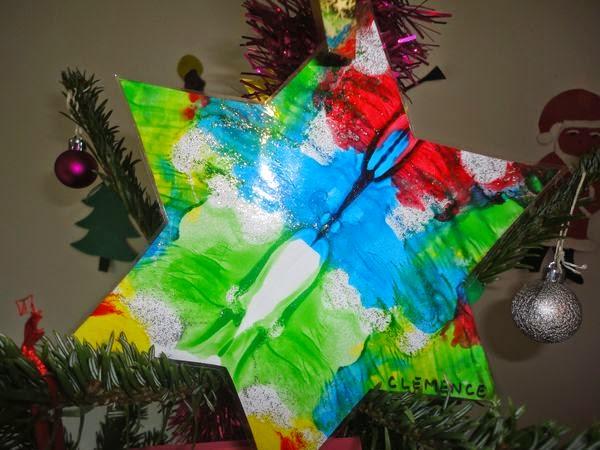 etoile en papier peinture et plastifiée