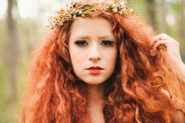red curly wedding hair down with floral crown