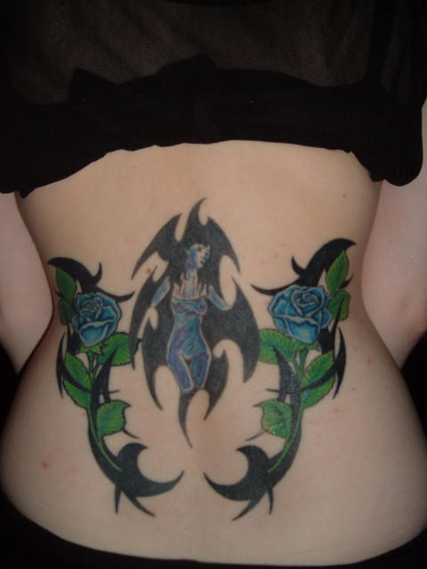 lower back tattoo designs for women. sexy ack