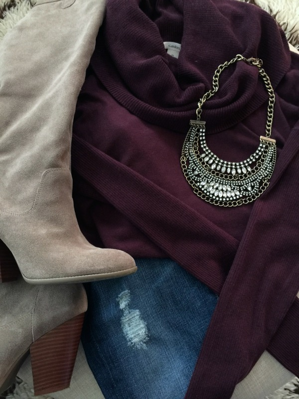 Cowl neck sweater, boots and  necklace.