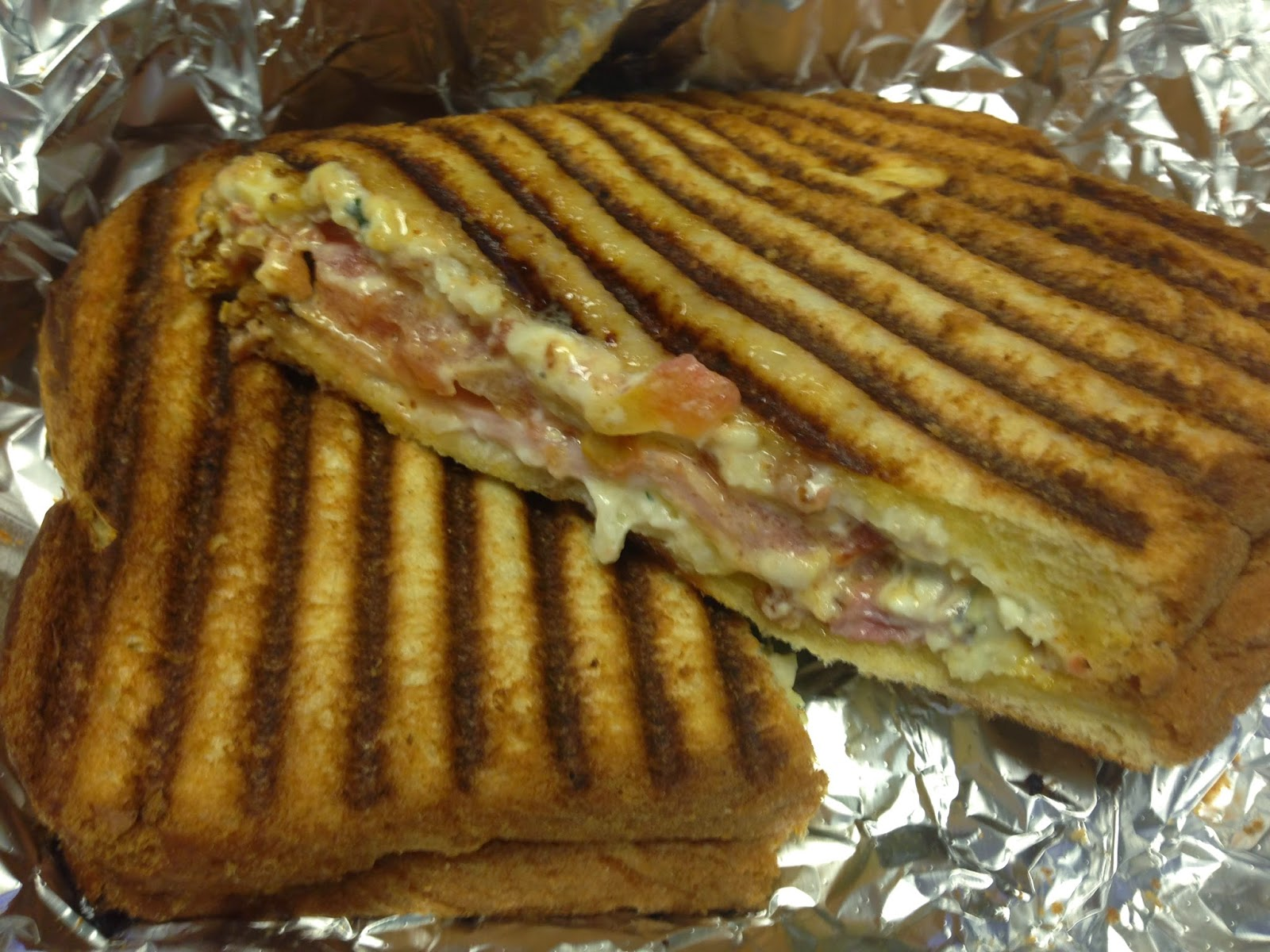 Cheezy Rider Food Truck - The Copper Penny, grilled Challah, cheese, ham, bacon, tomatoes, and chipotle honey mustard