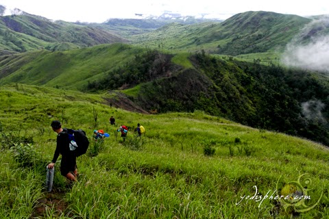 Mountaineers hiking the Mt. Cinco Picos grassland trail traverse to Silanguin Cove  hover_share