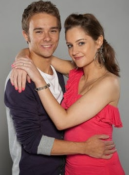 A picture of David and Kyle from Coronation Street standing with their arms around each other