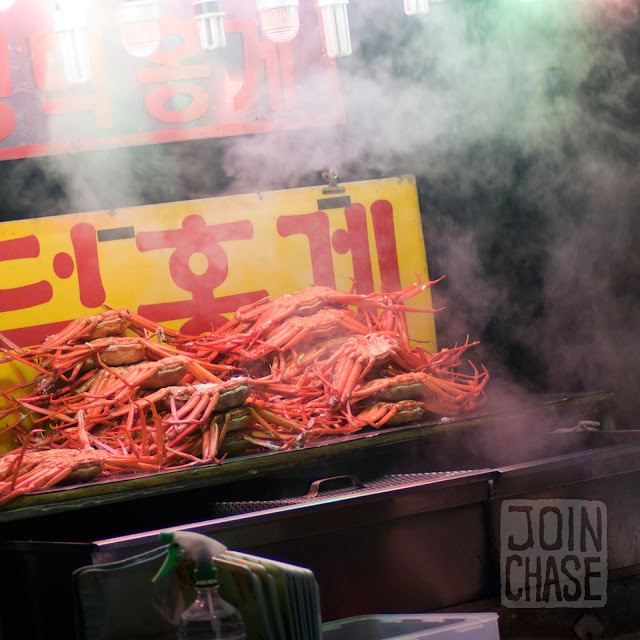 A man selling crabs on a street in Jinju, South Korea.