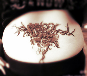 lower back flower tattoo