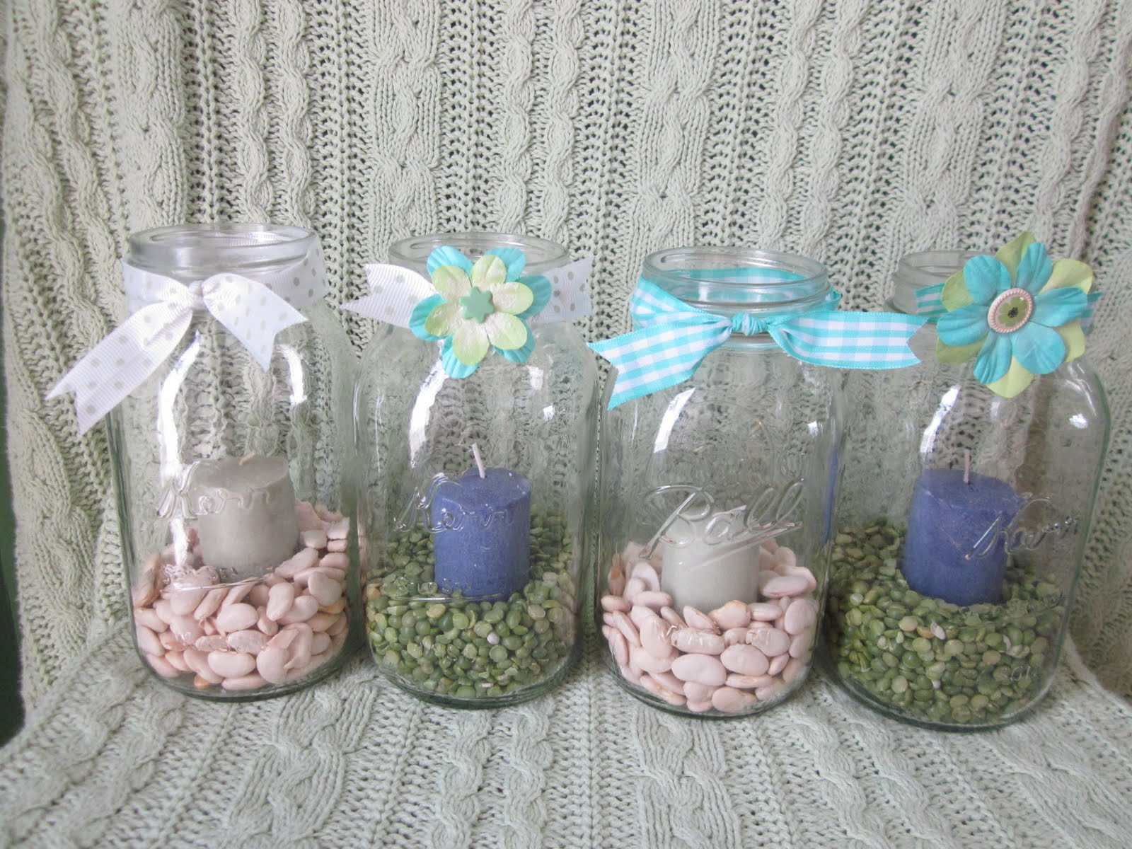 more canning jar decor i filled these with dry split peas and lima beans added candles and bows and hot glued some paper flowers on a couple of the