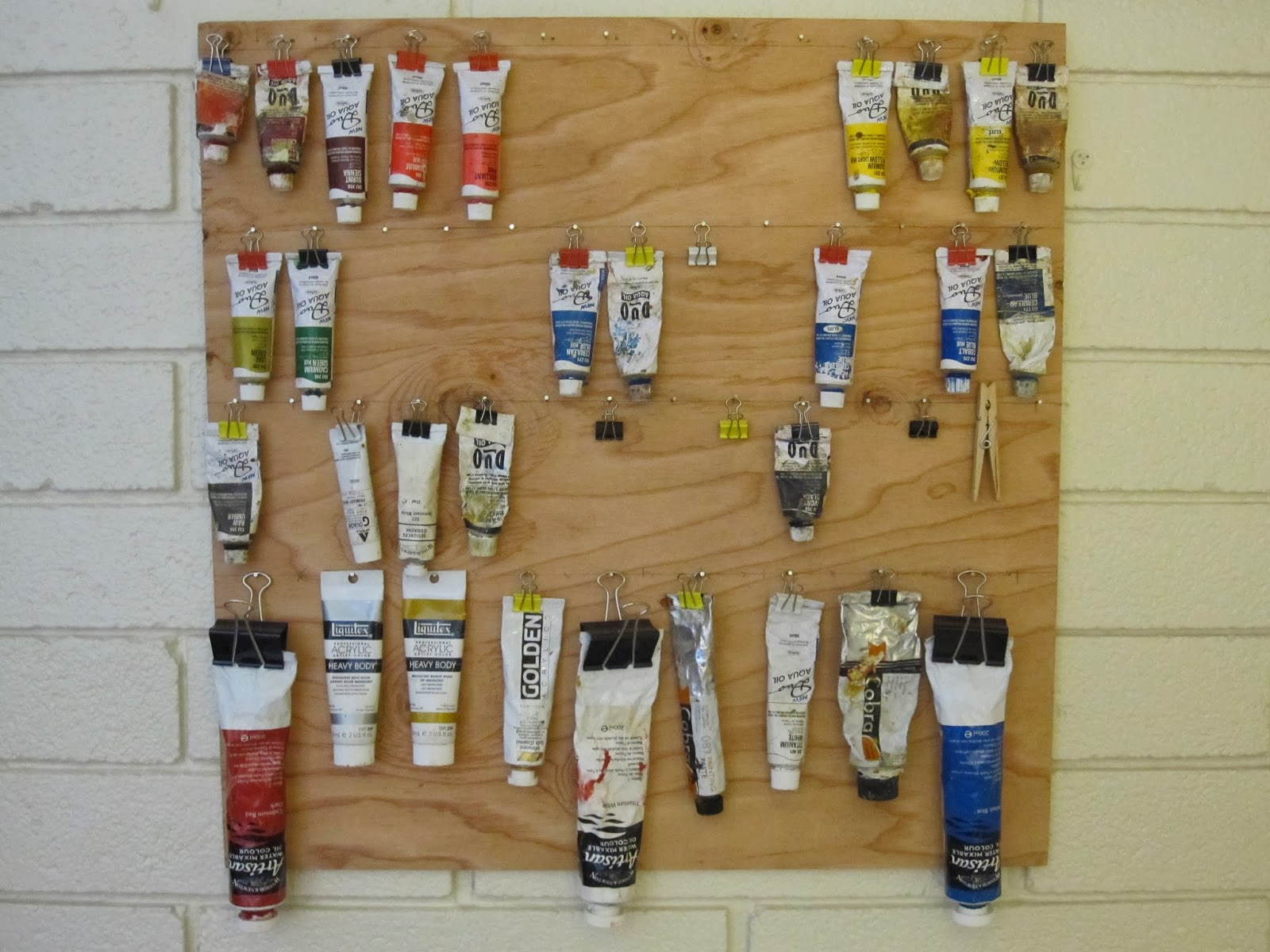 oil paint hanging display and storage with binder clips & Mike is Bored: Paint tube display and storage rack on wall.