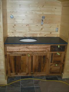 rustic oak vanity, stone countertops, http://huismanconcepts.com/