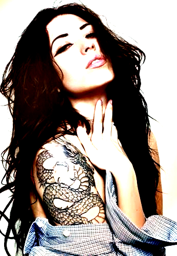 model with dragon tattoo on arm
