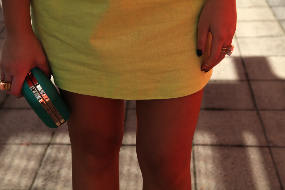 neon mini dress and green satin clutch on epique