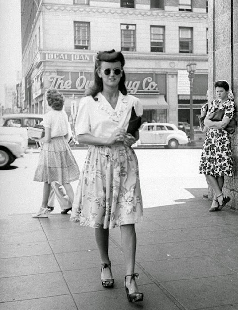 1940's woman wearing a button down shirt