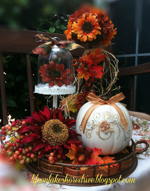 fall vignette pumpkin fall flowers cloche