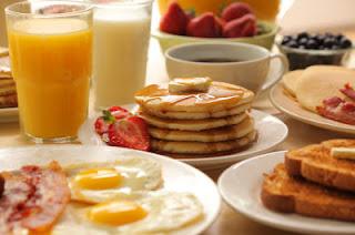 Luxury Breakfast with pancakes, waffles, orange juice, bacon, the works