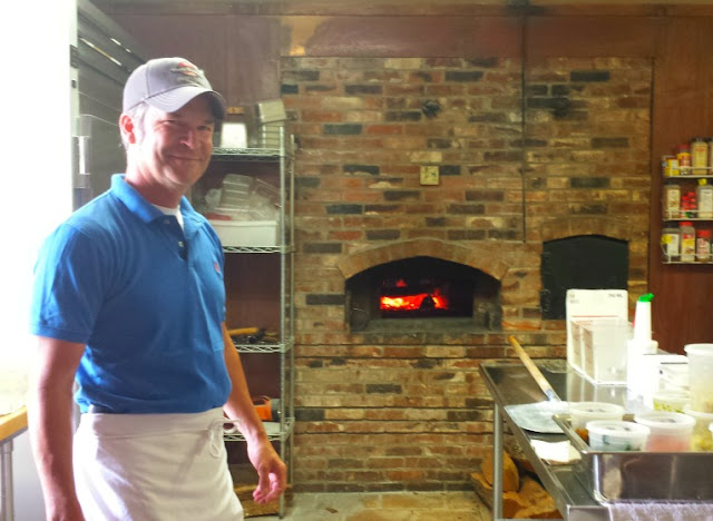 Every Sunday, Elkin Creek Vineyard lights the brick oven for gourmet pizzas.