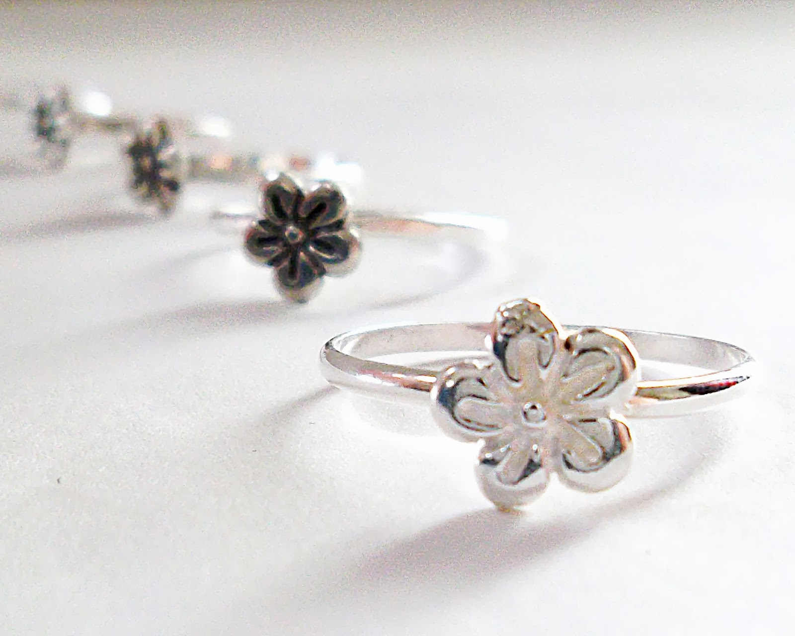 https://www.etsy.com/listing/178174024/sterling-silver-flower-ring-made-to