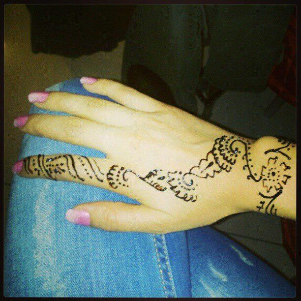 Henna art design tattoo on hand